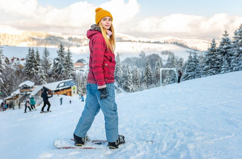 Young beautiful girl snowboarding on winter royalty free stock images