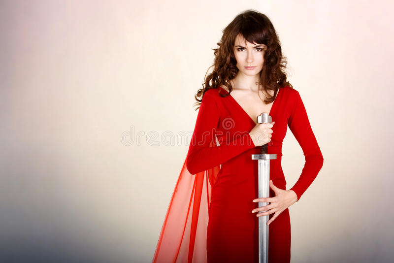 Young beautiful girl with a sword royalty free stock photo