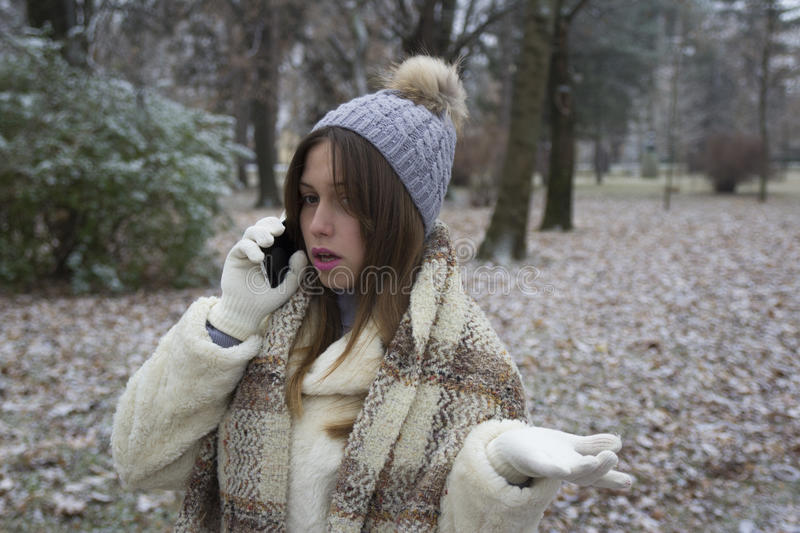 Download Young Beautiful Girl Talking On A Mobile Phone Stock Photo - Image: 83721409