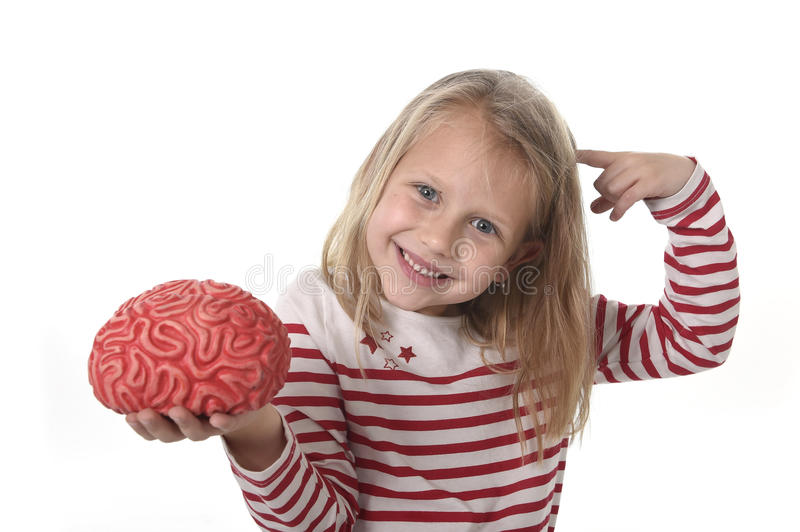 Young beautiful girl 6 to 8 years old playing with rubber brain having fun learning science concept stock image