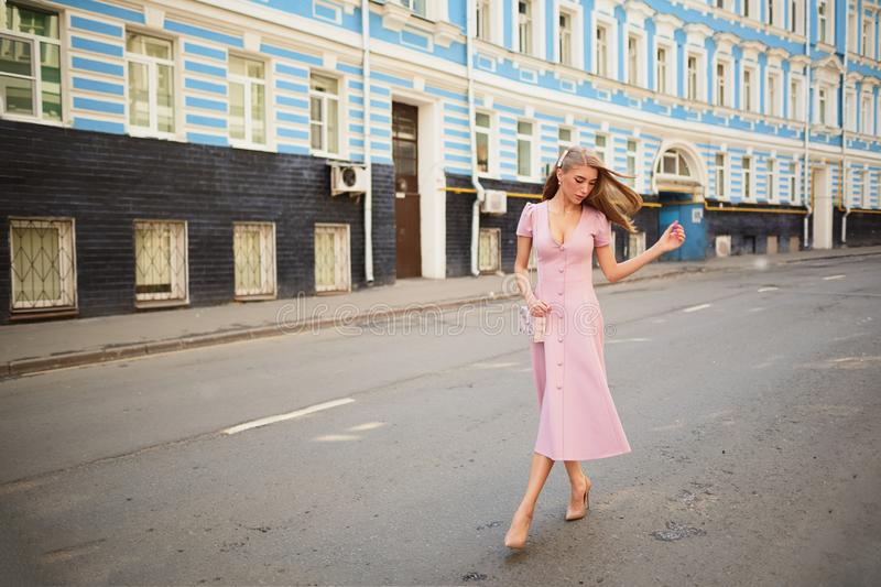 Fashionably dressed woman on the streets of a small town, shopping concept stock images
