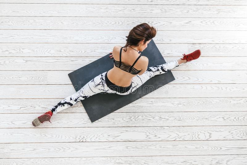 Woman doing fit exercise on white flooring royalty free stock photo