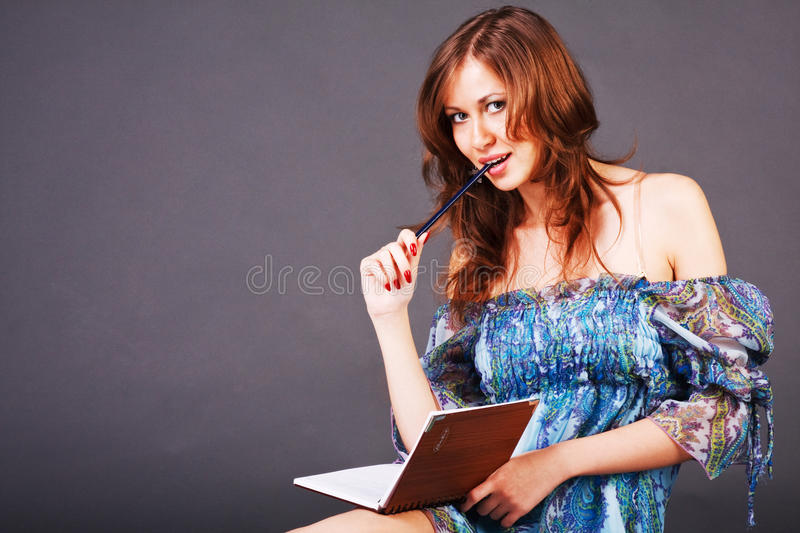 Young beautiful girl writes poetry royalty free stock photos