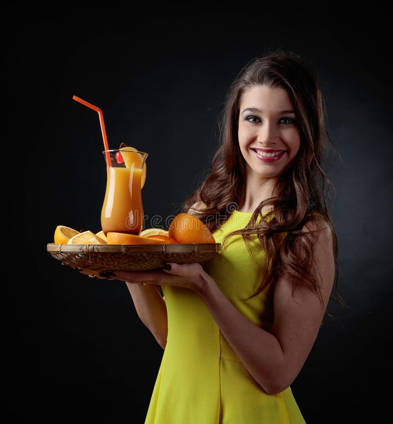 Young beautiful girl in a yellow dress with cocktail Tequila Sun stock photo