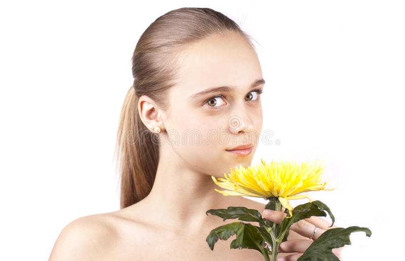Download Young Beautiful Girl With Yellow Flower Stock Photo - Image of smiling, health: 23059546