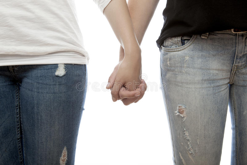 Young beautiful girls holding hands stock image