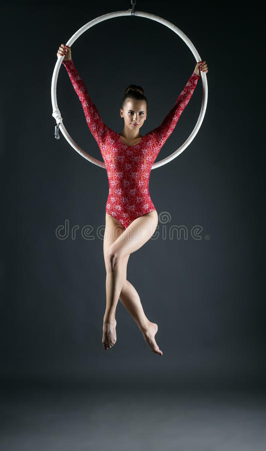 Young beautiful gymnast performs with hoop royalty free stock images