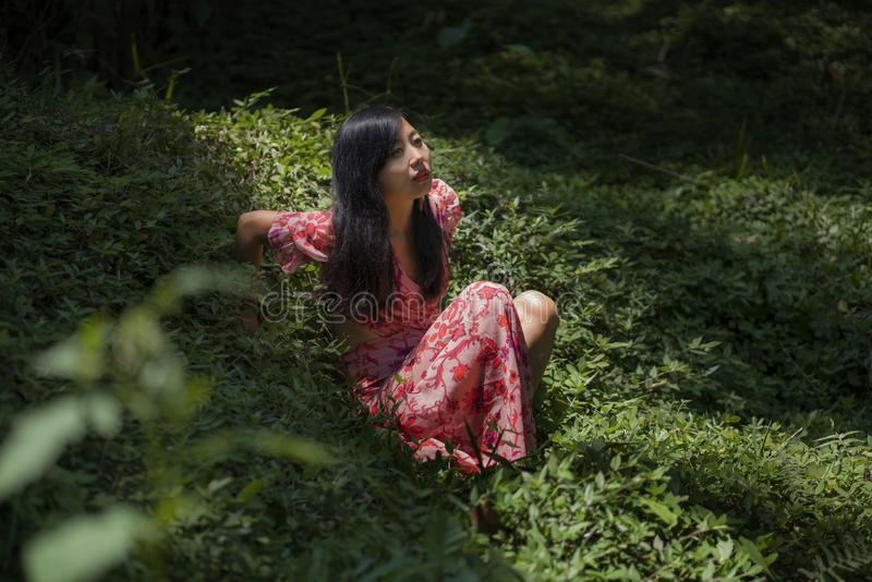 Young beautiful and happy Asian Chinese woman in stylish dress enjoying adventure holiday trip exploring the beauty of nature at royalty free stock images