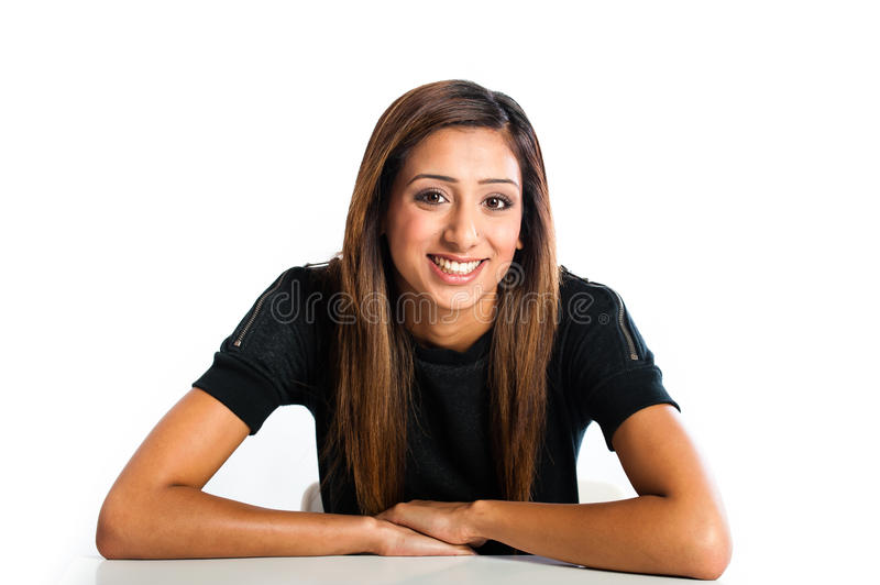 Young beautiful happy Asian Indian teenager. Posing in studio stock photography