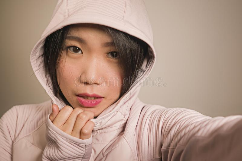Young beautiful and happy Asian Korean student woman taking selfie portrait photo for using social media app enjoying playful royalty free stock photo