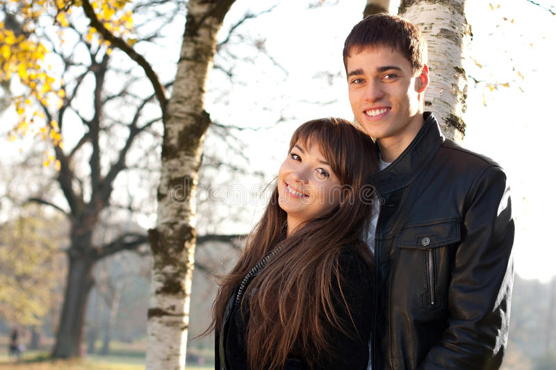 Young beautiful happy couple in love in outdoors royalty free stock photos