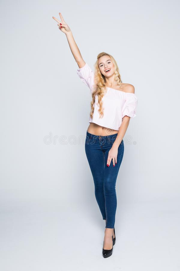 Young beautiful happy girl portrait with hand up isolated on white. Young beautiful girl portrait with hand up isolated on white royalty free stock photo