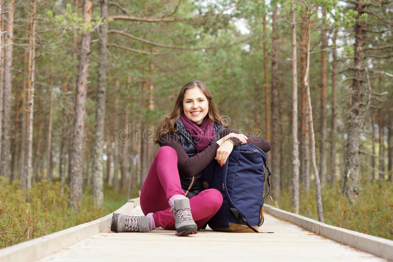 Young, beautiful and happy woman walking in forest. Camp, adventure, trip, hiking concept royalty free stock image