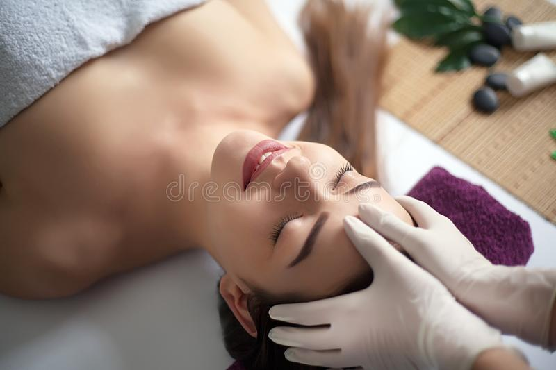 Young, beautiful and healthy woman in spa salon. Traditional oriental massage therapy and beauty treatments. Young, beautiful and healthy woman in spa salon royalty free stock image