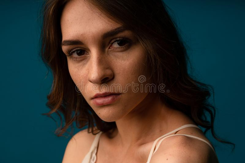 Young beautiful hispanic sad woman serious and concerned looking worried and thoughtful facial expression feeling depressed stock photos