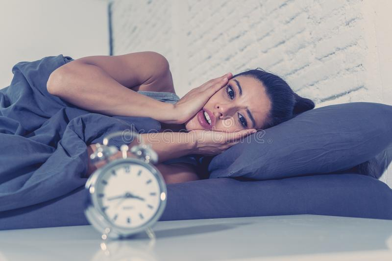 Pretty latin woman can`t sleep in insomnia concept stock image
