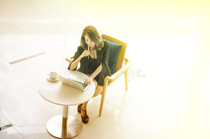 Young beautiful iAsian businesswoman working with computer Think Success in company royalty free stock images
