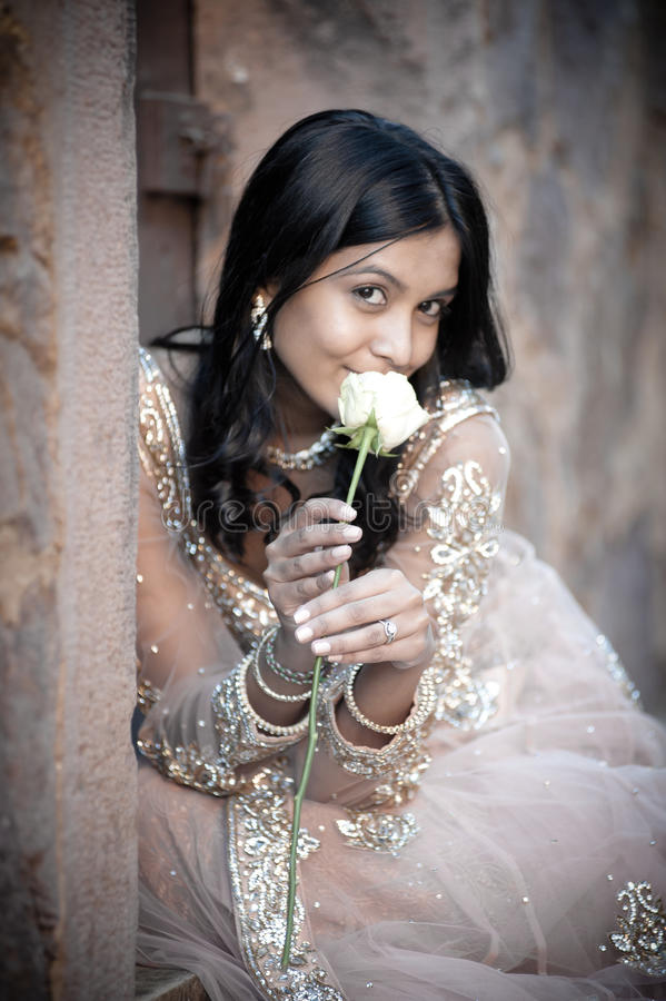 Free Young Beautiful Indian Woman Sitting Against Stone Wall Outdoors Royalty Free Stock Photos - 42353208