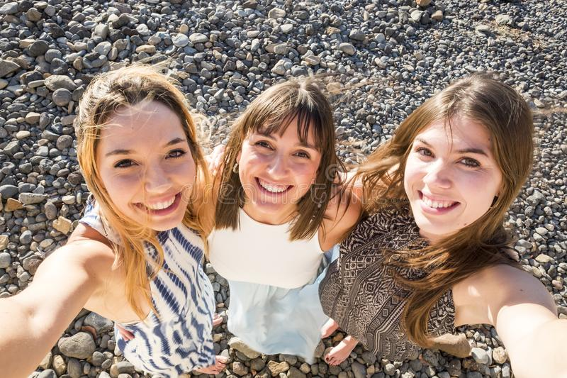 Three Beautiful long hair young women in vacation. Young beautiful long hair women 25 years old in vacation outdoor in tenerife. Freedom and independence concept stock images