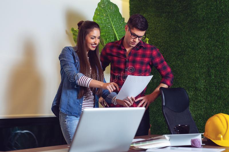 Young male and female architects working on a project together. - Image royalty free stock images