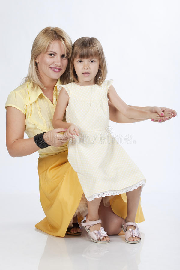 Young beautiful mother and 5 years old daughter stock photo