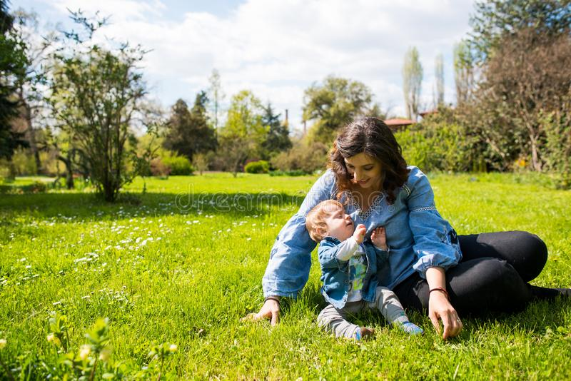 Happy loving family. mother and child playing in the park royalty free stock photo