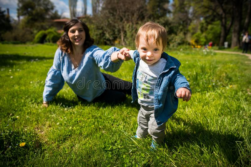 Happy loving family. mother and child playing in the park stock images