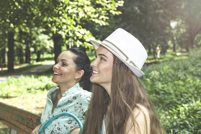 A happy family. Young beautiful mother and teenager daughter having fun laughing on a walk royalty free stock photo