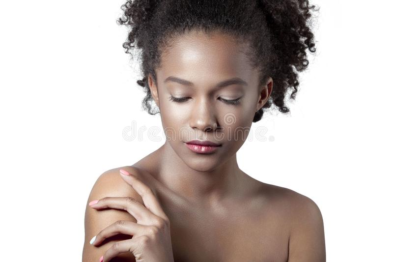 Young beautiful mulatto girl with clean perfect skin close-up. Beauty portrait stock images