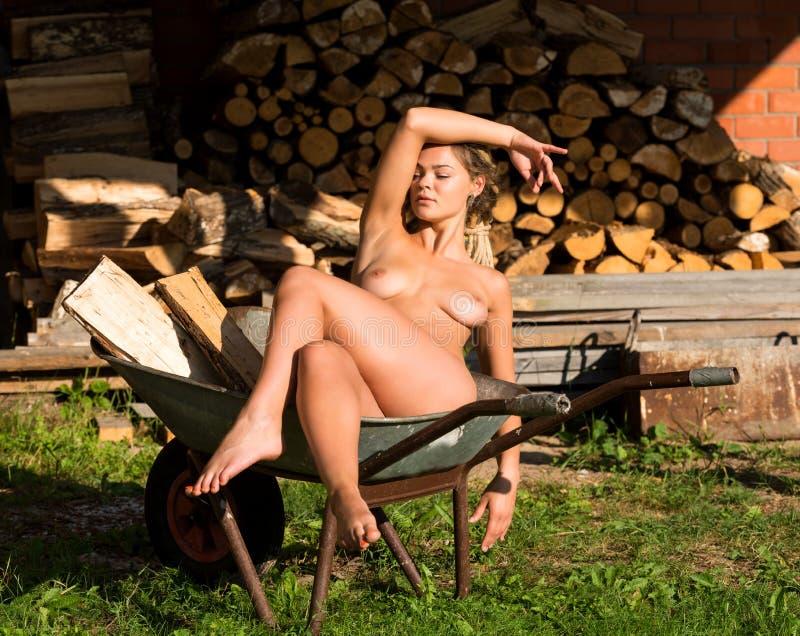Nude girls on wheel barrows