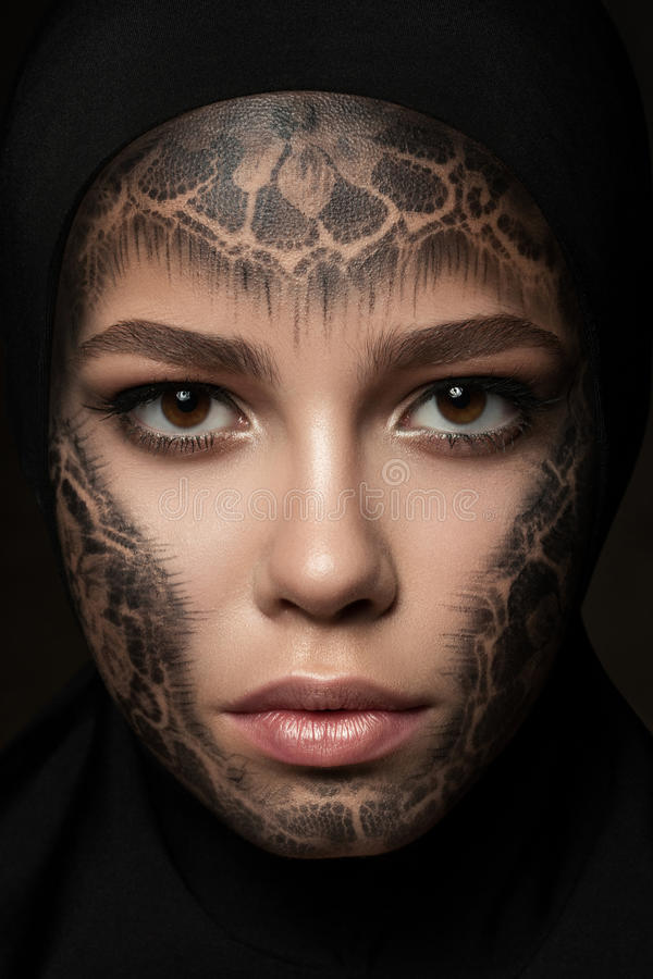 Young beautiful nun with faceart stock images