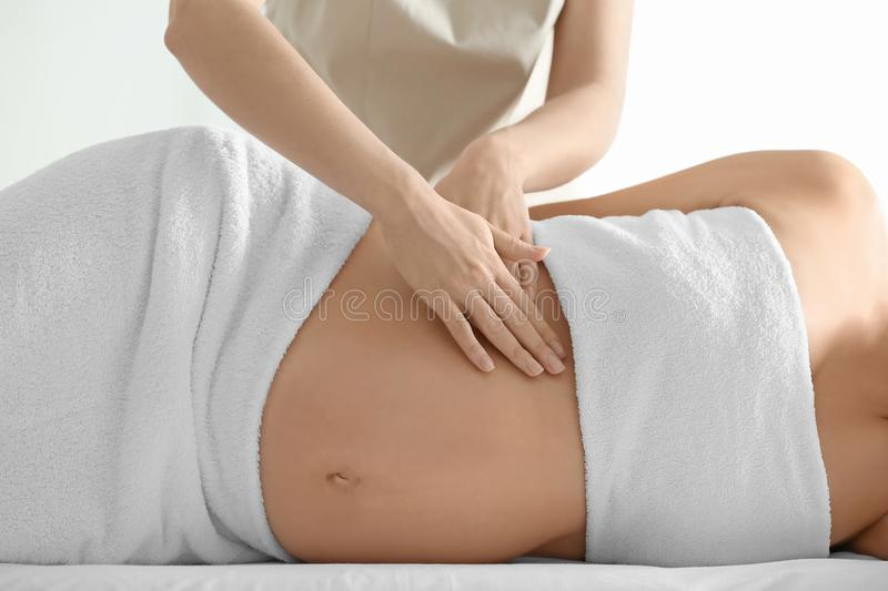 Young beautiful pregnant woman having massage royalty free stock photo