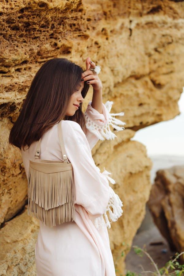 Young stylish girl wearing shorts and jacket royalty free stock photography