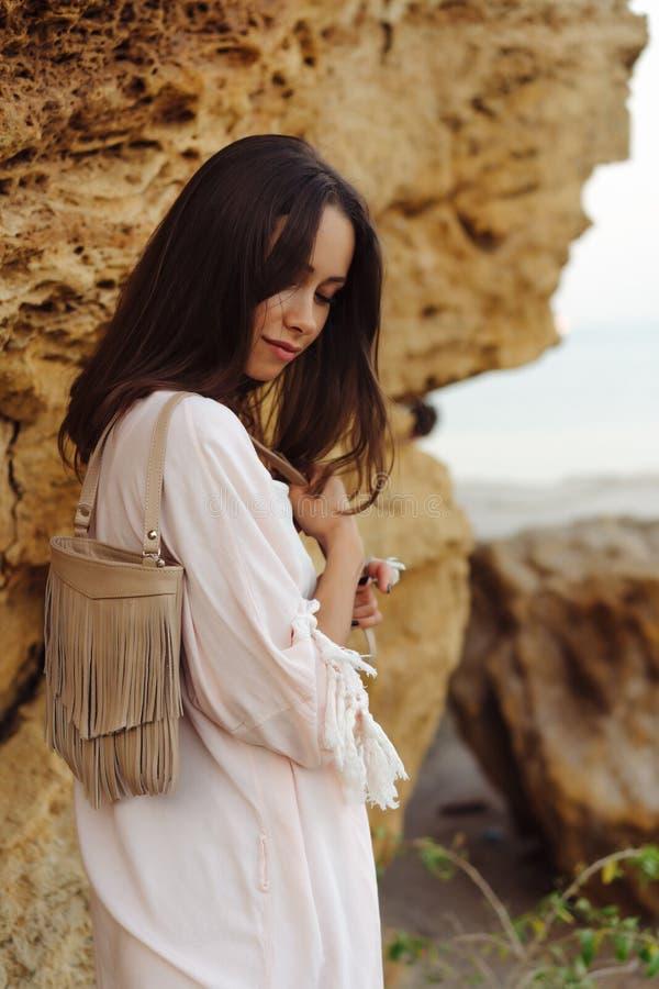 Young stylish girl wearing shorts and jacket royalty free stock photo