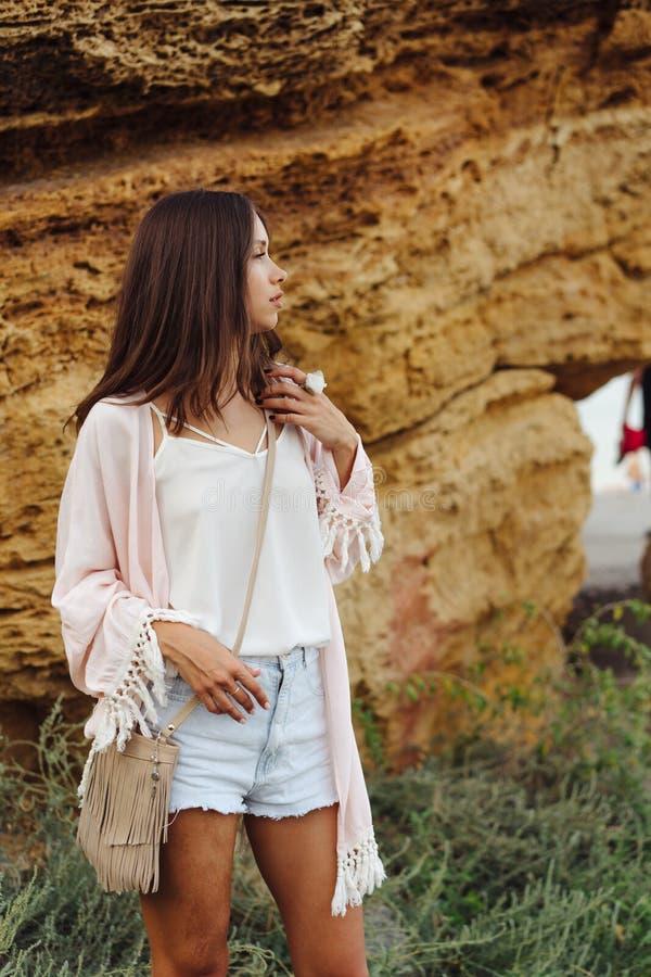 Young stylish girl wearing shorts and jacket stock images