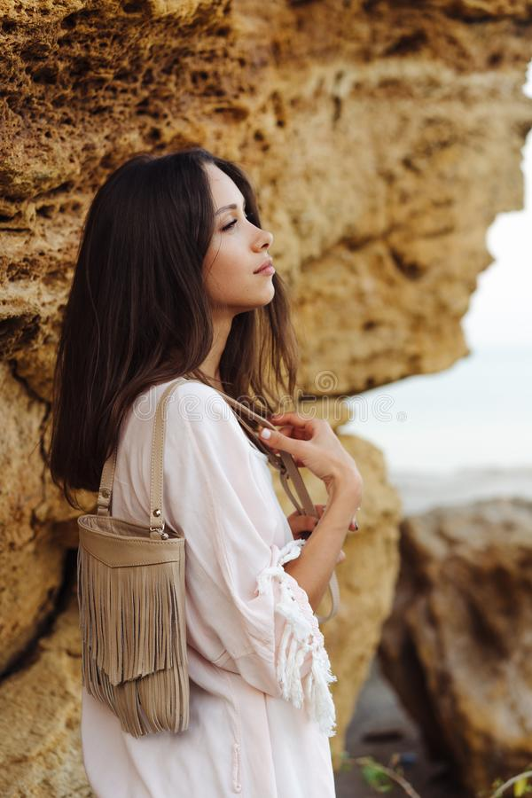 Young stylish girl wearing shorts and jacket stock photos
