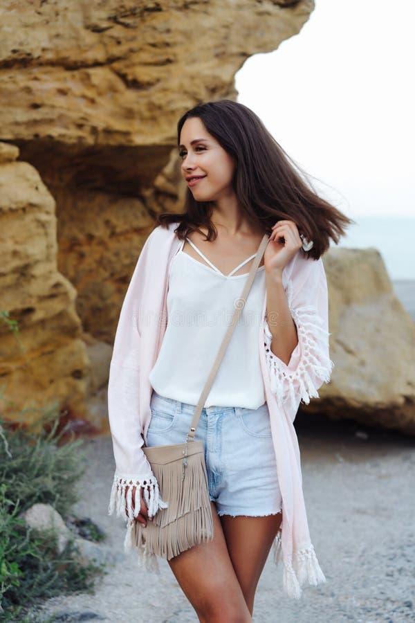 Young stylish girl wearing shorts and jacket stock photography