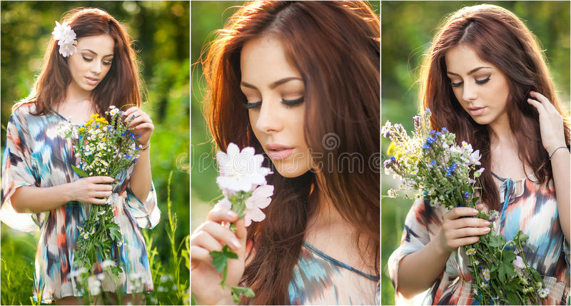 Young beautiful red hair woman holding a wild flowers bouquet in a sunny day. Portrait of attractive long hair female with flowers royalty free stock photo