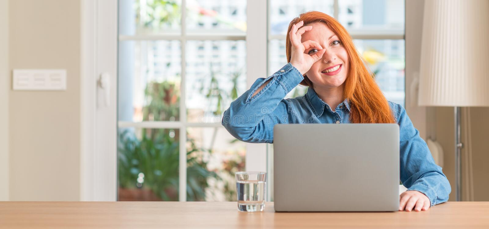 Young beautiful redhead woman at home stock images