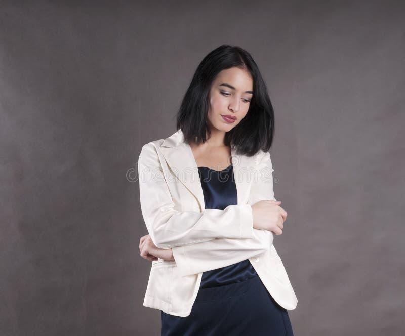Young beautiful sad emotion standingwork model businesswoman brunette studio royalty free stock photo