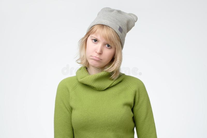 Young beautiful sad nordic woman looking worried and thoughtful. Facial expression while feeling depressed, being in sadness and sorrow emotion stock photography