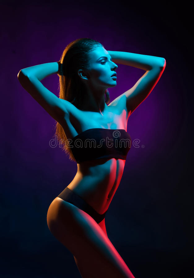 Young, beautiful and seductive girl posing in swimsuit. Mixed and fashionable lightning effect royalty free stock photo