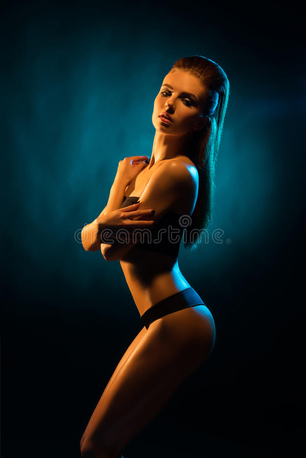 Young, beautiful and seductive girl posing in swimsuit. Mixed and fashionable lightning effect stock image