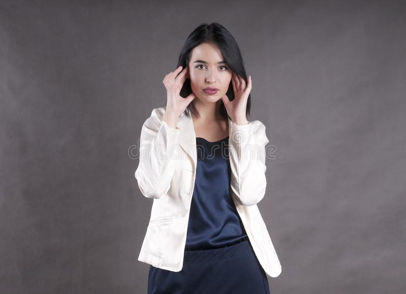 Young beautiful serious confident jacket model businesswoman brunette studio royalty free stock images