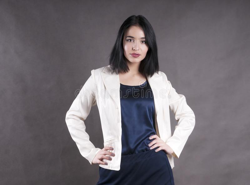 Young beautiful serious emotion standingwork model businesswoman brunette studio stock photo
