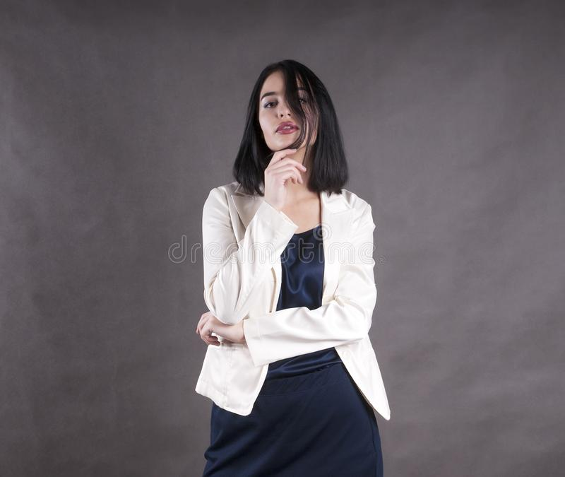 Young beautiful serious businesswoman brunette studio stock photography