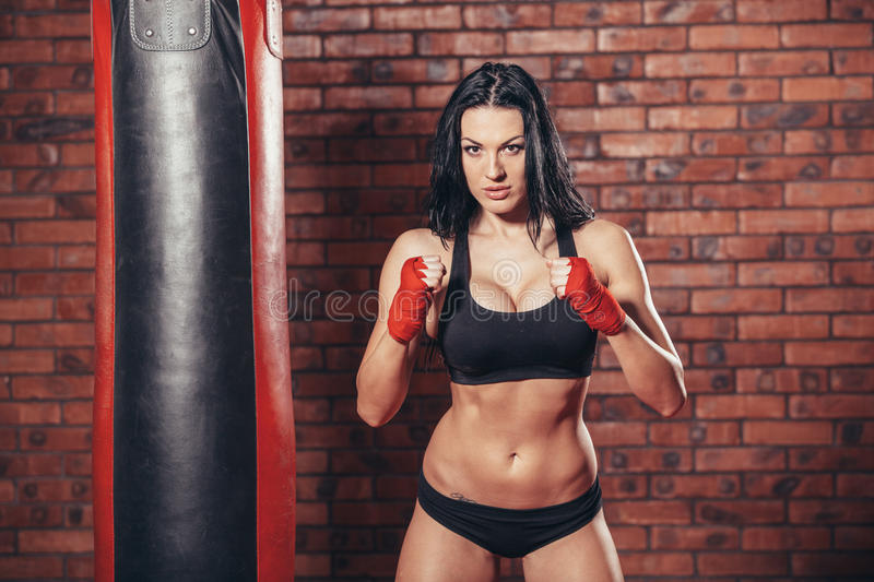 Young beautiful boxer woman with red boxing stock images