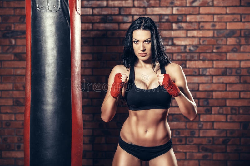 Young beautiful boxer woman with red boxing royalty free stock image