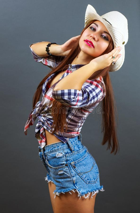 Young beautiful sexy girl in cowboy hat royalty free stock photos