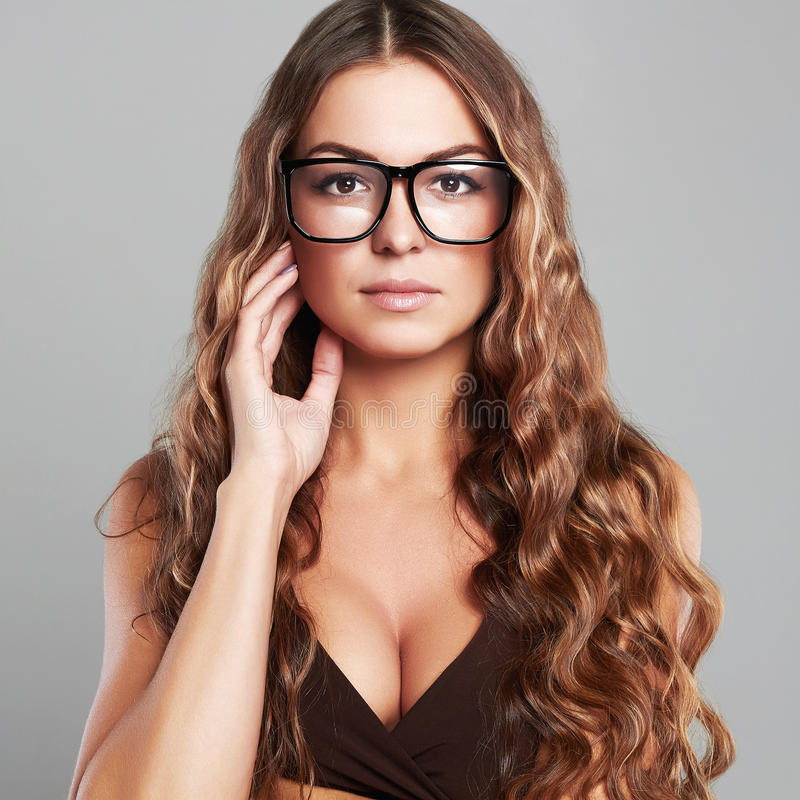 Young beautiful woman in glasses.healthy long hair. Fashion portrait of young beautiful woman in glasses.Beauty girl with healthy long hair.teacher stock photo